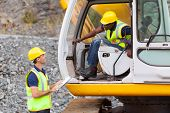 image of heavy equipment operator  - cheerful construction foreman talking to excavator operator - JPG