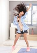 picture of pyjama  - Happy young woman acting as pop star - JPG