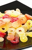 pic of jelly babies sugar  - Sweet mixed colorful jelly candies with studio lighting - JPG