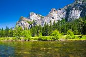 image of granite dome  - Three Brothers Rock with Merced River in Yosemite National Park - JPG