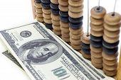 Dólares & close-up do ábaco