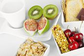 stock photo of roughage  - Breakfast with fruits and energy bar with studio lighting - JPG