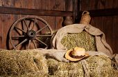Interior of a rural farm - hay wheel cowboy hat.