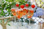 Summer Cocktail With Champagne, Peppermint And Fresh Strawberries