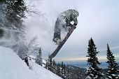 Snowboarder Jumping And Doing Nose Grab