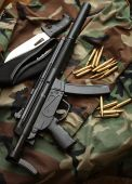 stock photo of mp5  - A MP5 type Automatic weapon with Knife and Beret hat 