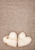 pic of rude  - Wooden hearts on the rude burlap background - JPG