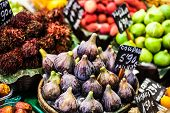 Colourful Fruit And Figs At Market Stall In Boqueria Market In Barcelona.