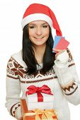 stock photo of post-teen  - A young woman with a Christmas present and cards - JPG