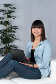 Woman Uses A Netbook