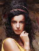 beautiful young brunette woman wearing yellow evening dress