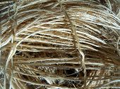 Bundle of straw colored rope string