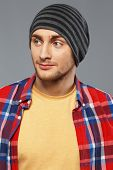 pic of beanie hat  - Stylish young man in shirt and beanie hat - JPG