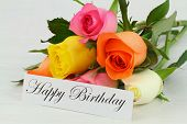 Happy Birthday card and colorful bouquet of roses