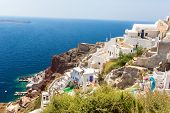 View Of Fira Town - Santorini Island,crete,greece. White Concrete Staircases Leading Down To Beautif