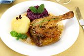 stock photo of roast duck  - Duck leg with potato dumplings red cabbage and gravy top view - JPG