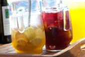 picture of mint leaf  - Sangria Jars and Orange juice in a table - JPG