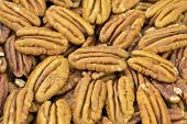 foto of pecan  - Pecan nut halves closeup  natural healthy nutrition - JPG
