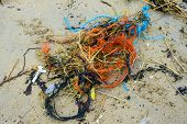 stock photo of polution  - Pollution at the beach nets and cords - JPG