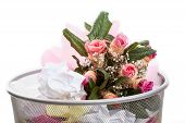 picture of dustbin  - A pink bouquet of flowers in a dustbin - JPG