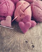 Crochet Pink Hearts  And Yarn On Wooden Background. Selective Focus