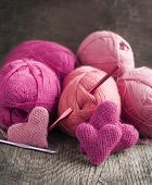 Crochet Pink Hearts  And Yarn On Wooden Background
