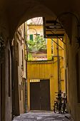 Backstreet with bicycles in Lucca, Tuscany