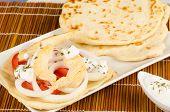 foto of gyro  - Freshly made chicken gyros with pita bread - JPG