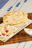 image of gyro  - Freshly made chicken gyros with pita bread - JPG