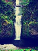 multnomah waterfalls in oregon done with a retro vintage instagram filter