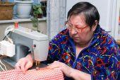 Senior Woman Using Sewing Machine