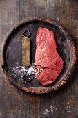 Raw Fresh Meat And Vintage Steelyard On Dark Background