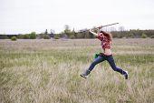 Woman With Rake Run Around Farm Field