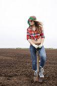 Woman Listen Music Pushing Shovel In Ground