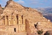 PETRA, JORDAN - MARCH 15, 2014: Tourists near the Monastery, Petra's largest monument. Since 1985, P