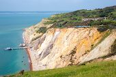Alum Bay beach Isle of Wight with beautiful rocks next to the Needles tourist attraction