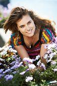 Young Beautiful Girl Next Door With Purple Flowers