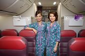 HONG KONG, CHINA - MAY 12, 2014: Malaysian Airline crew members posing in Boeing 737 aircraft after