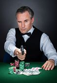 Portrait Of A Croupier Aiming With A Gun