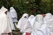 KANDY, SRI LANKA - FEBRUARY 26, 2014: Group of muslim women wearing traditional clothes. Muslims in Sri Lanka make 9.72% population.