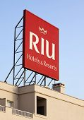 Puerto Rico, Spain - June 26, 2011: RIU Hotels & Resorts logo on billboard on top of RIU Vistamar Ho