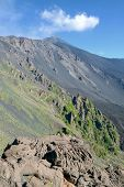 steep slope of Bove Valley and summit of Etna south east crater, Sicily