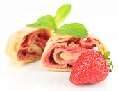 Tasty homemade strudel with fresh strawberry and mint leaves isolated on white