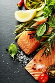picture of salmon steak  - Delicious  portion of fresh salmon fillet  with aromatic herbs - JPG