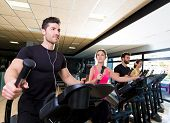 Aerobics elliptical walker trainer group at fitness gym workout
