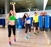 foto of cardio exercise  - dance cardio people group training at fitness gym workout exercise - JPG