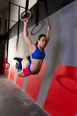 Muscle ups rings woman swinging workout exercise at gym