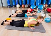 Pilates Yoga training exercise in fitness gym people group