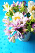 Bouquet of freesias in pail on table close-up