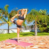 Woman Training Yoga Natarajasana